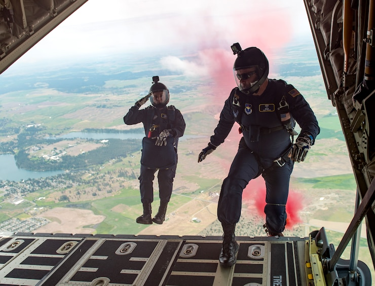 U.S. Air Force Academy cadet Sara Hill and Staff Sgt. Billy Price, Wings of Blue parajumpers, back off of the C-130 Hercules ramp from 4,500 feet during the 2019 Skyfest Open House and Airshow performance at Fairchild Air Force Base, Washington, June 22, 2019. Fairchild opened its gates to the public for a free one-day event to showcase Pacific Northwest airpower and U.S. Air Force capabilities. The airshow included the F-22 Demonstration Team, U.S. Army Golden Knights and 11 other aerial acts. (U.S. Air Force photo by Airman 1st Class Whitney Laine)