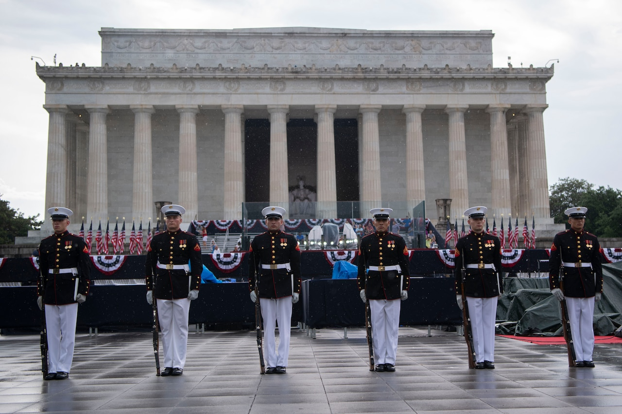 Members of the Marine Corps Silent Drill Platoon stand in front of the Lincoln Memorial.