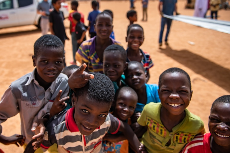 Nigerien children gather around for a photo at a village in Agadez, Niger, June 27, 2019. The 724th Expeditionary Air Base Squadron civil engineer flight built a new classroom for the village so they can learn in a more stable structure. (U.S. Air Force photo by Staff Sgt. Devin Boyer)