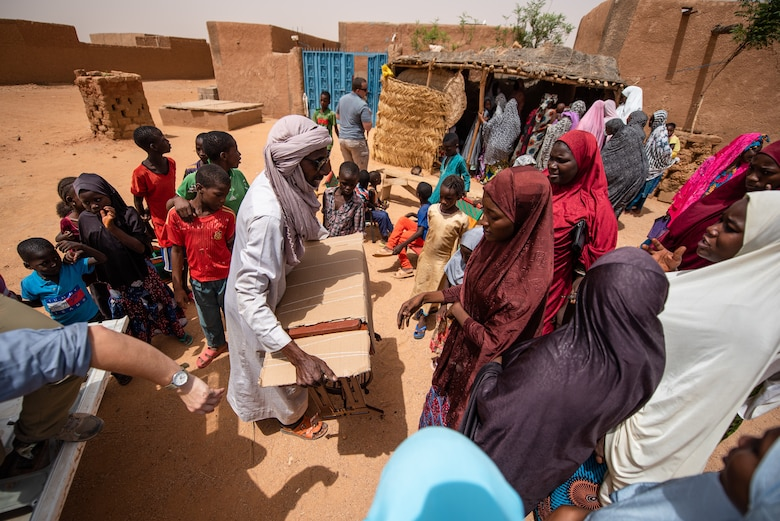 Nigerien women accept a donation of sewing supplies from Nigerien Air Base 201's Women's Association in Agadez, Niger, June 27, 2019. The village uses the sewing equipment to make a variety of products they sell, so they can provide for their families. (U.S. Air Force photo by Staff Sgt. Devin Boyer)