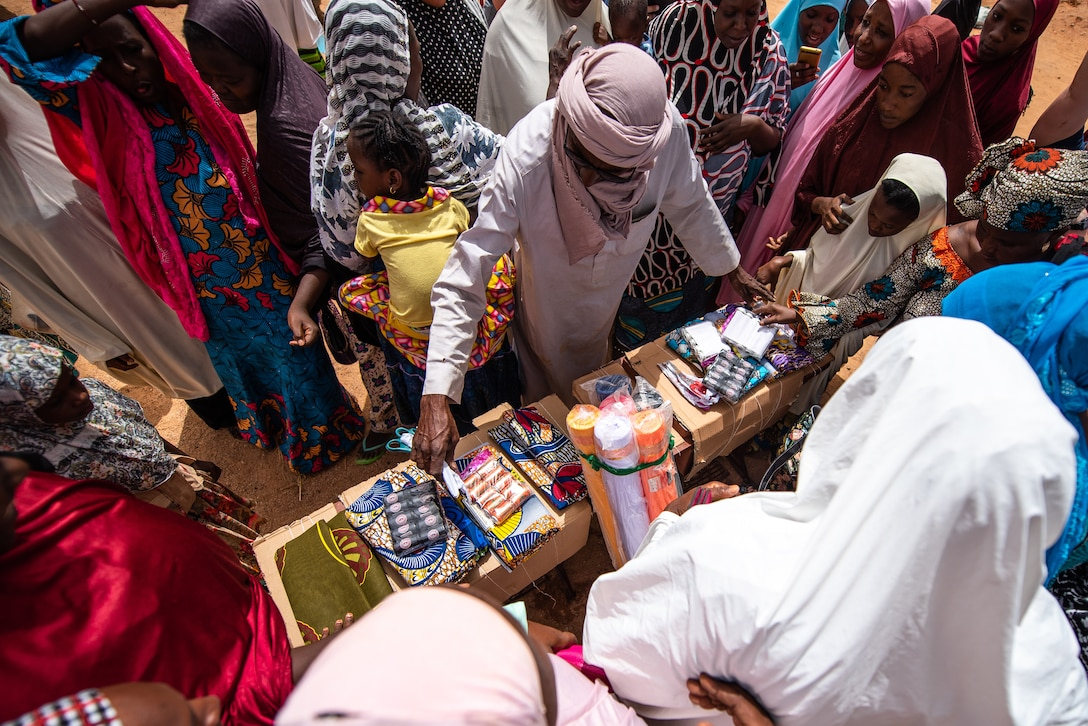 Nigerien women accept a donation of sewing supplies from Nigerien Air Base 201's Women's Association in Agadez, Niger, June 27, 2019. Donations like these help build strong relationships between the base and the community. (U.S. Air Force photo by Staff Sgt. Devin Boyer)