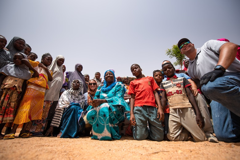 Nigeriens, and Nigerien Air Base 201 personnel pose for a photo at a village in Agadez, Niger, June 27, 2019. The women's association from the base donated sewing supplies to the village. (U.S. Air Force photo by Staff Sgt. Devin Boyer)