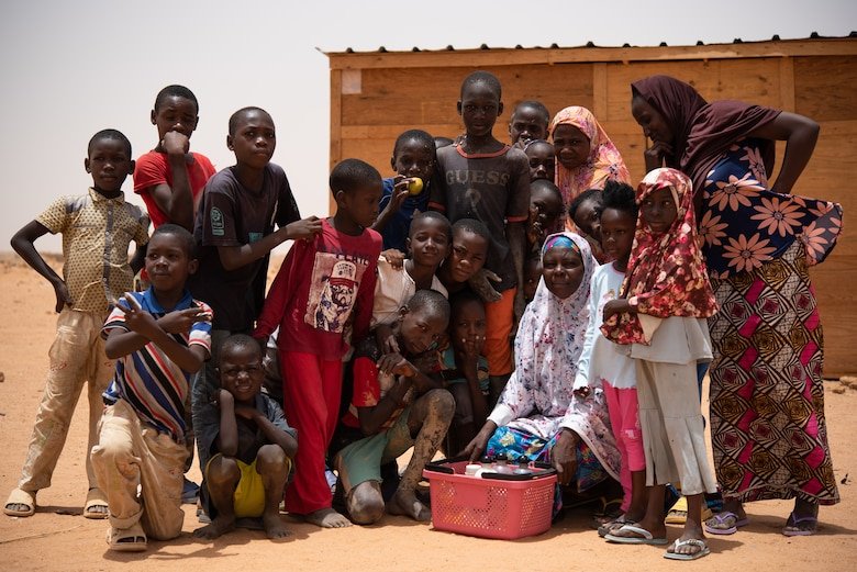 Nigeriens pose for a photo in front of a classroom at a village in Agadez, Niger, June 27, 2019. The 724th Expeditionary Air Base Squadron civil engineer flight built the classroom for the village. (U.S. Air Force photo by Staff Sgt. Devin Boyer)