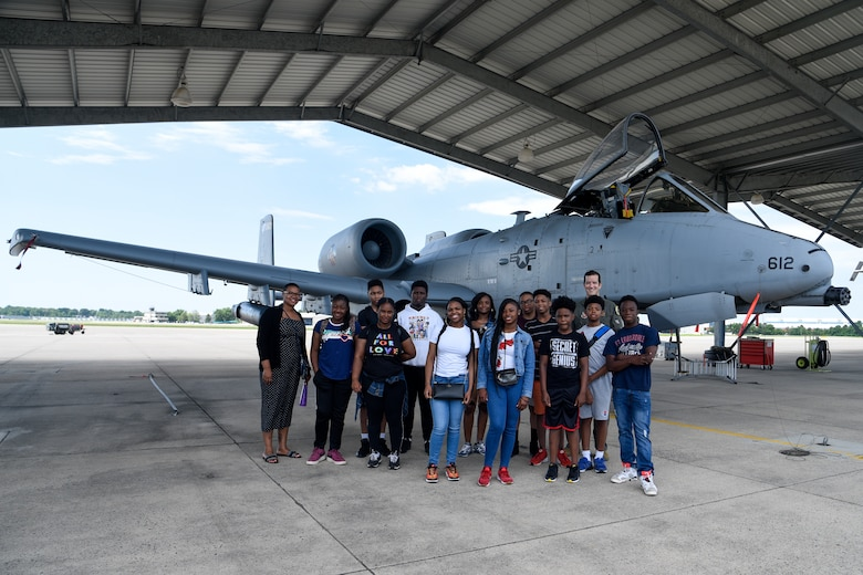 Students from the Baltimore City Department of Recreation and Parks Science, Technology, Engineering and Math program pose for a group photo, July 3, 2019, at Martin State Airport, Middle River, Md. The students, ranging from 9th – 12th grade, were introduced to the A-10C Thunderbolt II aircraft and simulator as well as Electro-Optical and Infrared (EOIR) sensors. (U.S. Air National Guard photo by Staff Sgt. Enjoli Saunders)