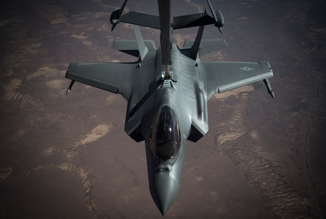An F-35A Lightning II conducts aerial refueling with a KC-10 Extender