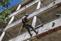 A U.S. Marine with Special Purpose Marine Air-Ground Task Force-Crisis Response-Africa 19.2, Marine Forces Europe and Africa, rappels from an abandoned building during exercise Long Precision 2019 in Navacerrada, Spain, June 11, 2019. U.S. Marine Corps snipers trained alongside snipers from Spain, Italy, France, and the U.S. Army's 173rd Airborne Brigade during Long Precision to increase their proficiency and multilateral interoperability. (U.S. Marine Corps photo by Capt. Clay Groover)