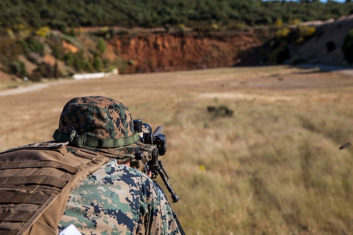 A U.S. Marine with Special Purpose Marine Air-Ground Task Force-Crisis Response-Africa 19.2, Marine Forces Europe and Africa, fires his M110 semi-automatic sniper system during a stress shoot for exercise Long Precision 2019 in Uceda, Spain, June 10, 2019. U.S. Marine Corps snipers trained alongside snipers from Spain, Italy, France, and the U.S. Army's 173rd Airborne Brigade during Long Precision to increase their proficiency and multilateral interoperability. (U.S. Marine Corps photo by Capt. Clay Groover)