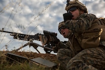 U.S. Marines with Special Purpose Marine Air-Ground Task Force-Crisis Response-Africa 19.2, Marine Forces Europe and Africa, fire an M240B machine gun during a squad attack on Campo De Maniobras, Base General Menacho, Spain, June 18, 2019. The Marines integrated with the Spanish Army to enhance interoperability with their allies. (U.S. Marine Corps photo by Cpl. Margaret Gale)