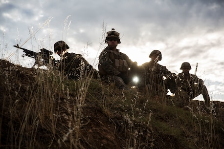 U.S. Marines with Special Purpose Marine Air-Ground Task Force-Crisis Response-Africa 19.2, Marine Forces Europe and Africa, prepare to fire their M240B machine gun during a squad attack on Campo De Maniobras, Base General Menacho, Spain, June 18, 2019. The Marines integrated with the Spanish Army to enhance interoperability with their allies. (U.S. Marine Corps photo by Cpl. Margaret Gale)