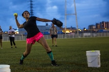 U.S. Marine Corps Chief Warrant Officer 2 Lydia M. Lindsey, a Distribution Management Analyst with Marine Corps Installations Pacific, pitches a softball during Frozen Rope challenge on Camp Foster, Okinawa, Japan, July 3, 2019.  The challenge is a trial to test a player's skills on how well a player can perform in a specific element of the sport.