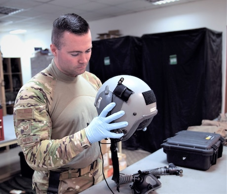 U.S. Air Force Staff Sgt. Zane Lemons, 779th Expeditionary Airlift Squadron aircrew flight equipment journeyman, inspects a flight helmet before certifying it for in-flight operations on Ali Al Salem Air Base, Kuwait, July 3, 2019. Aircrew flight equipment technicians provide vital life support equipment for aircrew members traveling around the U.S. Central Command area of responsibility. Lemons is deployed from the 120th Airlift Wing, Montana Air National Guard. (U.S. Air Force photo by Tech. Sgt. Michael Mason)