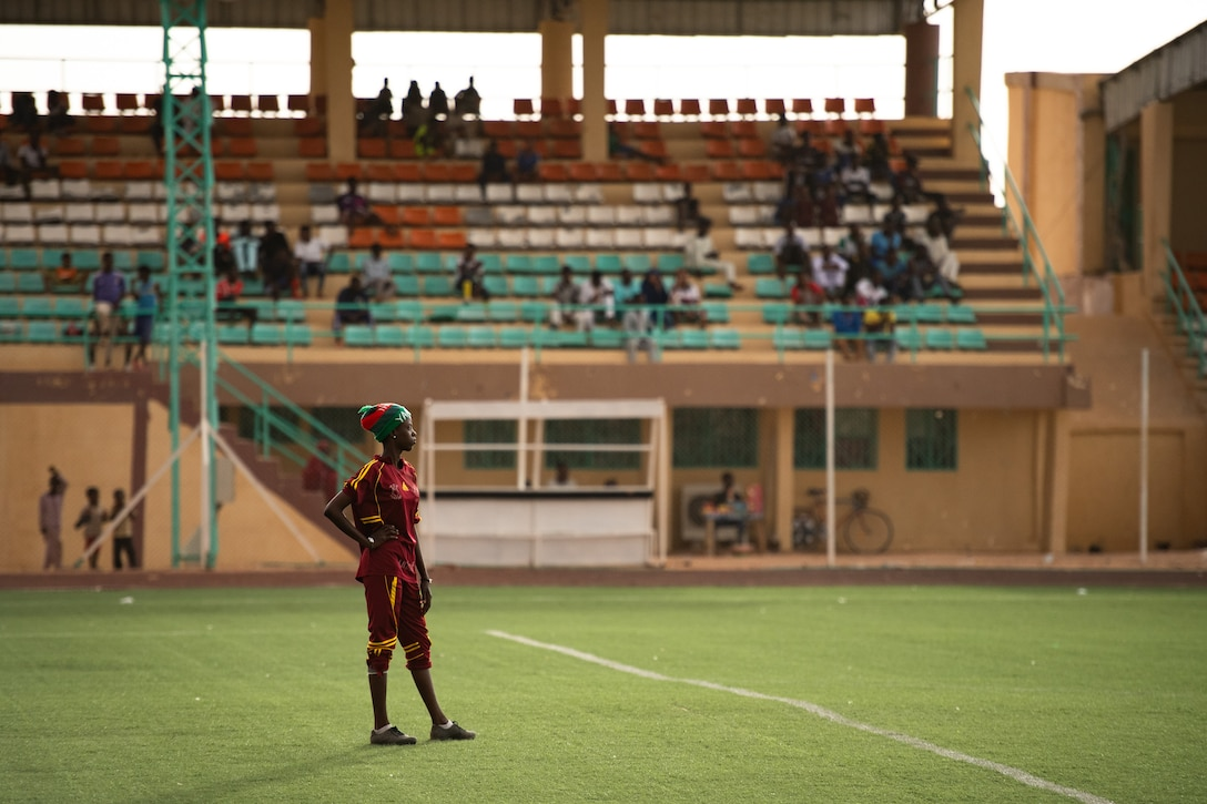 The goalie for the Nassara Athletic Club Women's Soccer Team observes the opposite side of the field during a recreational game between Nigerien Air Base 201 and the Nassara Athletic Club Women's Soccer Team at the Agadez Sports Stadium in Agadez, Niger, July 5, 2019. The civil affairs team held the game to build rapport and promote positive sentiment between the local community and AB 201 personnel. (U.S. Air Force photo by Staff Sgt. Devin Boyer)