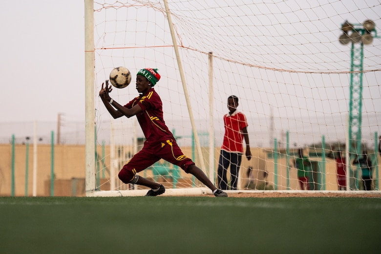 The goalie for the Nassara Athletic Club Women's Soccer Team attempts to block a goal during a recreational game between Nigerien Air Base 201 and the Nassara Athletic Club Women's Soccer Team at the Agadez Sports Stadium in Agadez, Niger, July 5, 2019. The civil affairs team held the game to build rapport and promote positive sentiment between the local community and AB 201 personnel. The game ended with a three on three shootout resulting in AB 201's victory. (U.S. Air Force photo by Staff Sgt. Devin Boyer)