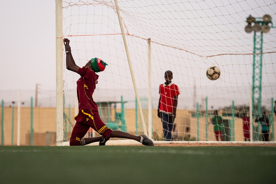 The goalie for the Nassara Athletic Club Women's Soccer Team misses the ball while blocking during a recreational game between Nigerien Air Base 201 and the Nassara Athletic Club Women's Soccer Team at the Agadez Sports Stadium in Agadez, Niger, July 5, 2019. The civil affairs team held the game to build rapport and promote positive sentiment between the local community and AB 201 personnel. The game ended with a three on three shootout resulting in AB 201's victory. (U.S. Air Force photo by Staff Sgt. Devin Boyer)