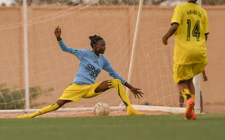 A player from the Nassara Athletic Club Women's Soccer Team stretches to block a goal during a soccer game against U.S. Air Force women from Nigerien Air Base 201 at the Agadez Sports Stadium in Agadez, Niger, July 5, 2019. The civil affairs team held the game to build rapport and promote positive sentiment between the local community and AB 201 personnel.  (U.S. Air Force photo by Senior Airman Lexie West)