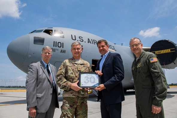 Col. Douglas Strawbridge, commander of the 911th Airlift Wing, receives a certificate from Chris Heck, President/CEO of the Pittsburgh Airport Area Chamber of Commerce, joined by Doug Keeter, Membership Director of the PAACC, and Col. Gregory Buchanan, commander of the 911th Operations Group, at the Pittsburgh International Airport Air Reserve Station, Pa., June 28, 2019. The certificate recognizes the 911th AW's 30 years of membership with the PAACC, a nonprofit organization which pledges to advance economic vitality by providing advocacy, information and services to their members and the business community. (U.S. Air Force photo by Joshua J. Seybert)