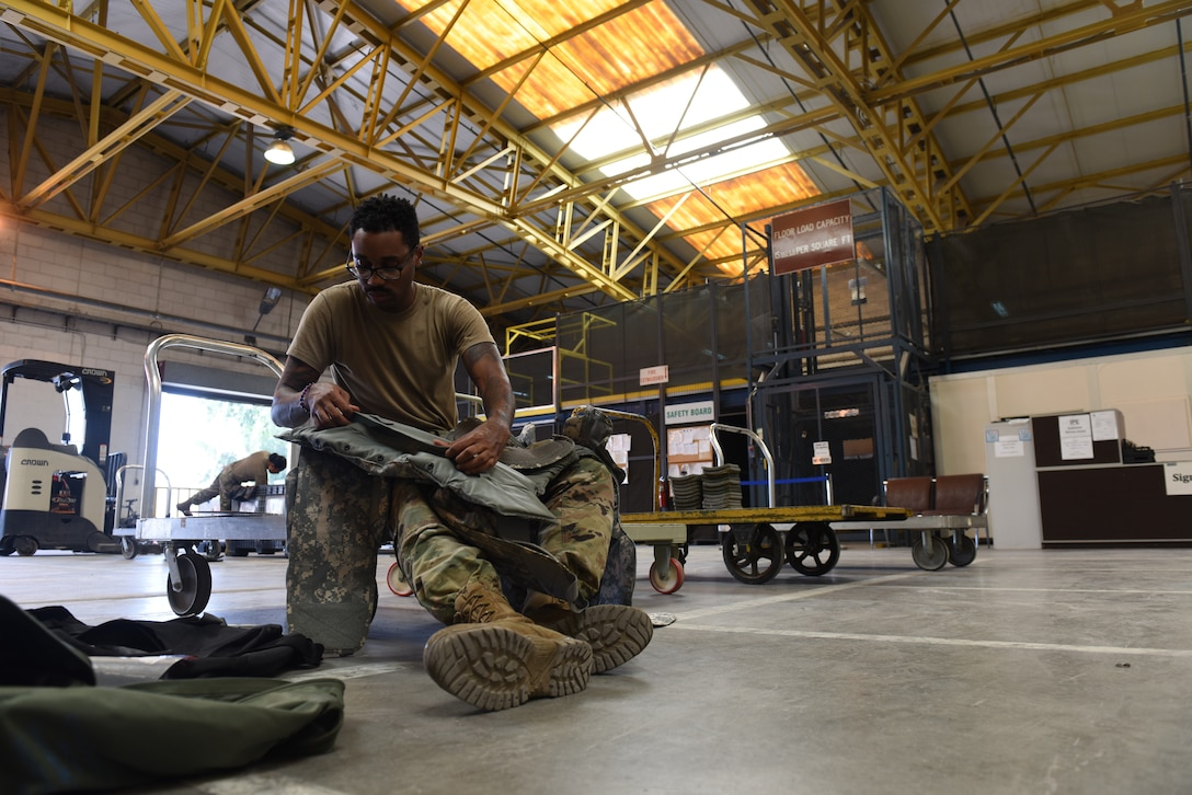 U.S. Air Force Staff Sgt. Tommie Hudson, 39th Logistics Readiness Squadron individual protection equipment supervisor, inspects body armor June 25, 2019, at Incirlik Air Base, Turkey. The IPE flight performs inspections of equipment to ensure the gear is serviceable. (U.S. Air Force photo by Staff Sgt. Matthew J. Wisher)