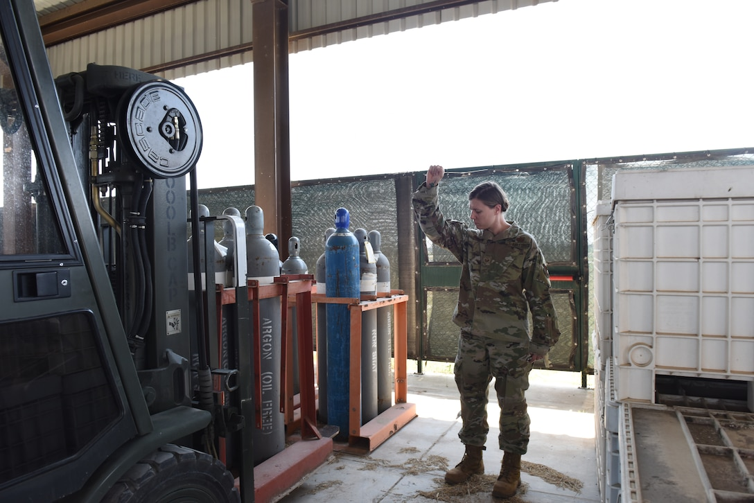 U.S. Air Force Tech. Sgt. Vanessa Acosta, 39th Logistics Readiness Squadron hazardous materials pharmacy noncommissioned officer in charge, spots a forklift June 25, 2019, at Incirlik Air Base, Turkey. The HAZMART flight controls, tracks and manages the distribution and use of hazardous materials on the installation. (U.S. Air Force photo by Staff Sgt. Matthew J. Wisher)