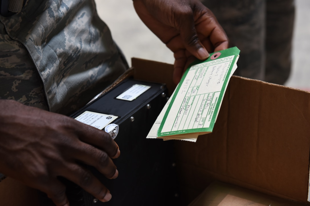 U.S. Air Force Senior Airman Dennis Smith, 39th Logistics Readiness Squadron flight service center journeyman, reviews an aircraft part ticket June 25, 2019, at Incirlik Air Base, Turkey. The Flight service center controls the repair process by storing, shipping and disposing parts to ensure aircraft remain operational to carry out missions. (U.S. Air Force photo by Staff Sgt. Matthew J. Wisher)