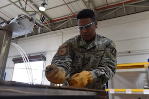 U.S. Air Force Senior Airman Sebastian Gonzalez, 39th Logistics Readiness Squadron outbound cargo journeyman, ties down equipment to be shipped June 25, 2019, at Incirlik Air Base, Turkey. The cargo flight receives and packages items for shipment, as well as determines the proper equipment for loading and unloading procedures. (U.S. Air Force photo by Staff Sgt. Matthew J. Wisher)
