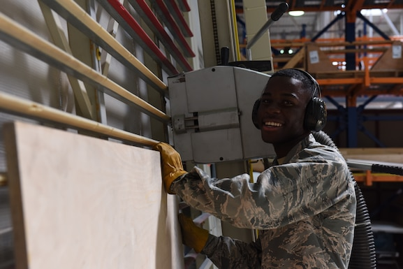 U.S. Airman Kokou Daglo, 39th Logistics Readiness Squadron inbound cargo journeyman, prepares to cut a board June 25, 2019, at Incirlik Air Base, Turkey. Along with inspecting items to determine serviceability, the cargo flight also constructs boxes for items that may require special handling during the shipping process. (U.S. Air Force photo by Staff Sgt. Matthew J. Wisher)