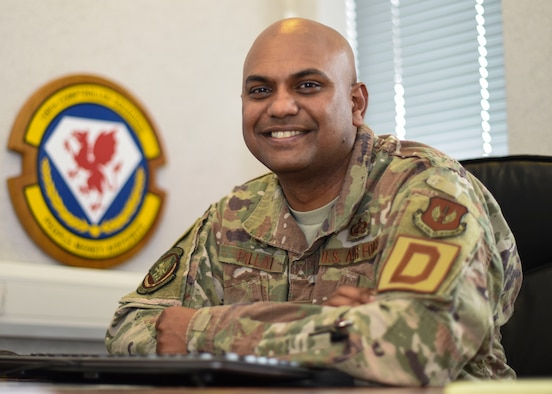 U.S. Air Force Maj. Triven Pillai in his office at RAF Mildenhall, England, June 17, 2019. Pillai earned three degrees from Washington State University while running his own business and working 40 hours per week. (U.S. Air Force photo by Airman 1st Class Joseph Barron)