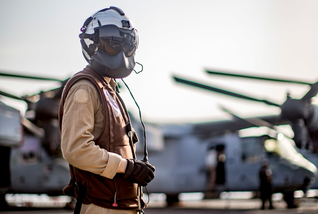 U.S. Marine Corps Cpl. Jia Wu, an MV-22 Osprey crew chief with Marine Medium Tiltrotor Squadron 163, 11th Marine Expeditionary Unit, stands on the flight deck of the amphibious assault ship USS Boxer during flight operations. The Boxer Amphibious Ready Group and the 11th MEU are deployed to the U.S. 5th Fleet area of operations in support of naval operations to ensure maritime stability and security in the Central Region, connecting the Mediterranean and the Pacific through the Western Indian Ocean and three strategic choke points.