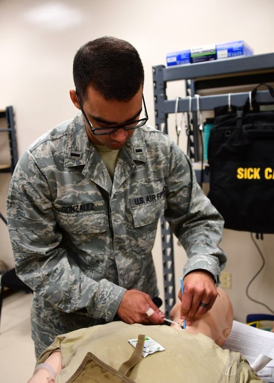 2nd Lt. Damian Gonzalez, flight nurse with the 911th Aeromedical Evacuation Squadron, practices opening an airway through the trachea at Fort Indiantown Gap, Pennsylvania June 19, 2019. This was one of the stations the members of the 911th Airlift Wing had to train at in preparation for their simulation with mechanical mannequins. (U.S. Air Force photo by Senior Airman Grace Thomson)