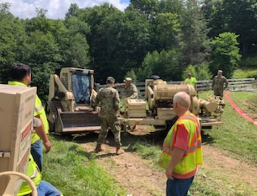 West Virginia Army National Guard Soldiers provide welfare checks, water distribution, and debris removal in and around Harman, West Virginia, July 7, 2019 to assist residents who were affected by flooding June 30, 2019. The Soldiers have distributed 65 cases of water and boxes of food to residents as well as delivered two water buffalos to provide potable water to those in need. (Courtesy photo)