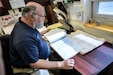 Dr. Everett Dague the NCO Leadership Center of Excellence Command Historian, reviews historical documents to verify the information provided through a submission on the historical website, on March 18.