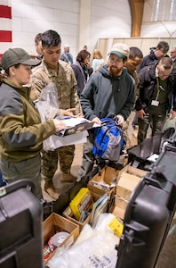 A field sampling team and a member of the 35th Civil Support Team (Weapons of Mass Destruction) inventory equipment March 12, 2019, at the West Virginia National Guard armory in Charleston, West Virginia. The West Virginia Division of Homeland Security and Emergency Management completed a Federal Emergency Management Agency (FEMA) full-scale exercise designed to test the agency's abilities to deal with a nuclear accident or event at the Beaver Valley Nuclear Power Plant in Beaver County, Pennsylvania. (U.S. Army National Guard photo by Bo Wriston)