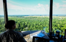 Senior Airman Bailey Hairston, 375th Operational Support Squadron air traffic controller, monitors the airspace over Scott Air Force Base