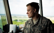 Senior Airman Nick Davis, 375th Operational Support Squadron air traffic controller, monitors flight data