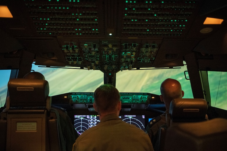 Israeli air force Air Attachés to the United States of America sit inside a KC-46A Pegasus flight simulator, July 1, 2019, at Altus Air Force Base, Okla. The 56th Air Refueling Squadron highlighted the training mission at the 97th Air Mobility Wing to showcase the world-class training and education of our nation's warfighters at Altus AFB. (U.S. Air Force photo by Airman 1st Class Breanna Klemm)