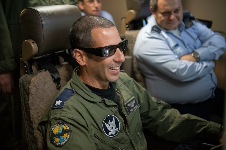 An Israeli air force Air Attaché to the United States of America member operates a KC-46A Pegasus boom operator simulator, July 1, 2019, at Altus Air Force Base, Okla. The visit from the IAF included a Formal Training Unit status briefing on training and construction, along with a KC-46A capability brief following time in a flight simulator. The trip concluded with a familiarization flight onboard a KC-46A. (U.S. Air Force photo by Airman 1st Class Breanna Klemm)