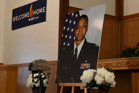 Maj. Stephen Osakue Jr., 14th Medical Support Squadron Pharmacy Flight commander's photo and memorial display sat at the front of the chapel during his memorial ceremony July 27, 2019, on Columbus Air Force Base, Miss. He is survived by his wife, Rosario Carrillo; son, Jordan; and daughter, Gabrielle. (U.S. Air Force photo by Senior Airman Keith Holcomb)