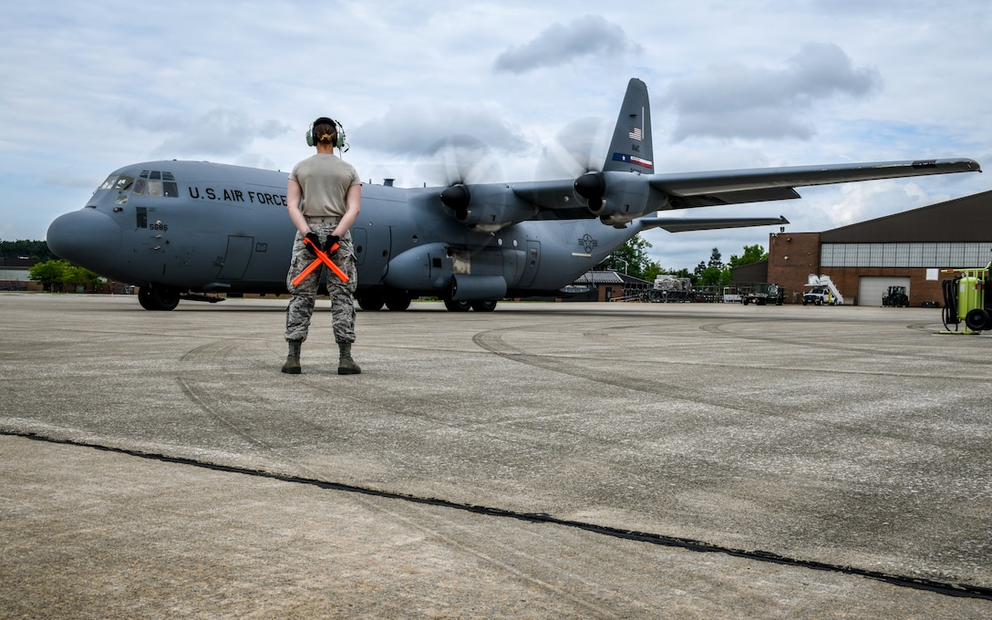A Reserve Citizen Airman from Youngstown Air Reserve Station, marshalls the pilots on a C-130J Super Hercules June 19, 2019, on the flightline here.
