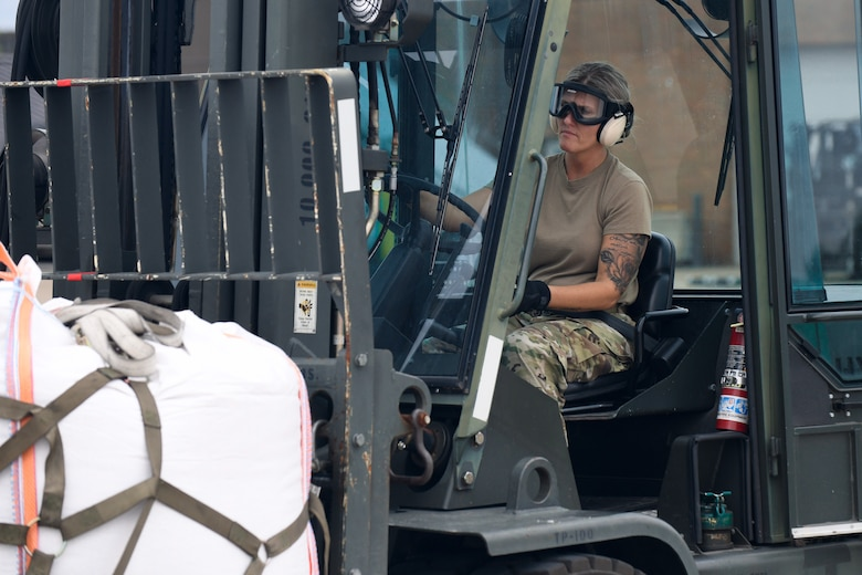 U.S. Air Force Tech. Sgt. Rebekah Sines, a motor vehicle operator with the 76th Aerial Port Squadron, transports humanitarian support cargo heading to Guatemala June 19, 2019, on the flightline here.