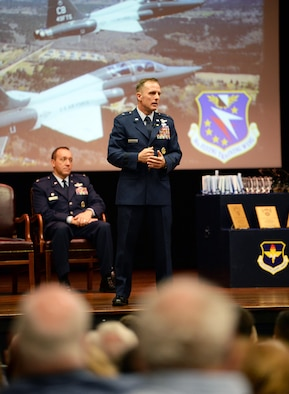 Retired Brig. Gen. John Cherrey, former Director of Intelligence, Operations and Nuclear Integration, Headquarters Air Education and Training Command at Joint Base San Antonio-Randolph, Texas, speaks to attendees during Specialized Undergraduate Pilot Training Class's 19-17/18 graduation in the Kaye Auditorium June 28, 2019, on Columbus Air Force Base, Miss. Cherrey spoke about his last 30 years as a pilot and wanted the newest generation of aviators to understand how important their job is. (U.S. Air Force photo by Airman Hannah Bean)