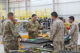 Lt. Col. Richard Brummond, Task Force Spartan, observes a part fabricated by Royal Jordanian Air Force that will go on a UH-60 Blackhawk helicopter during an aviation subject matter expert exchange at the King Abdullah II Air Base in Amman, Jordan, June 19, 2019.
