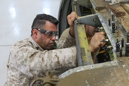 2nd Lt. Raad Alzubi, Royal Jordanian Air Force, aligns a fabricated sheet metal piece to a UH-60 Blackhawk helicopter during a subject matter expert exchange with the U. S. Army's 1106th Aviation Group at the King Abdullah II Air Base in Amman, Jordan, June 19, 2019.