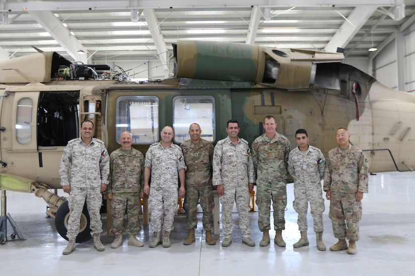 U. S. Army Soldiers and Royal Jordanian Air Force members gather for a photo while conducting an aviation subject matter exchange in Amman, Jordan, June 19, 2019.