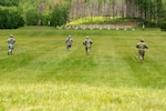 U.S. Air Force Airmen and U.S. Army Soldiers maneuver to firing positions during a marksmanship competition at the Camp Ethan Allen Training Site, Jericho, Vt., June 21, 2019. National Guard Airmen and Soldiers from six states compete in the Region 1 Marksmanship Advisory Council (MAC) competition where top competitors advance to the national Winston P. Willson championship. (U.S. Air National Guard photo by Master Sgt. Michael Davis)