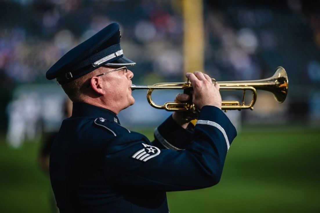 "Staff Sergeant Daniel Thrower, trumpeter from the USAF Heartland of Americca Band, performs ""Taps"" during a 4 July 2019 ceremony at Kauffman Station, Kansas City, Missouri, honoring our fallen service men and women."