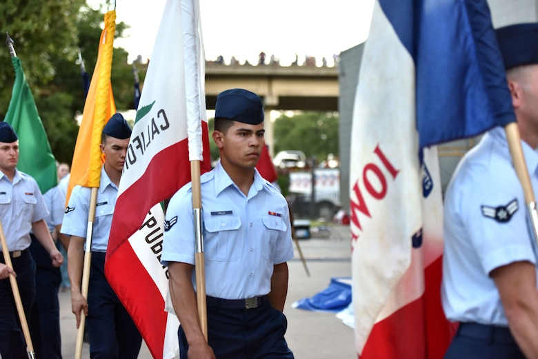 Goodfellow service members carry state flags representing the 50 states during the 32nd annual San Angelo Symphony Pops Concert at the Bill Aylor Sr. Memorial River Stage in San Angelo, Texas, July 3, 2019. The free concert was held as an early celebration of Independence Day. (U.S. Air Force photo by Senior Airman Seraiah Wolf/Released)