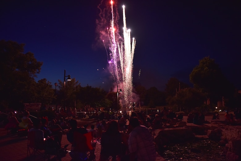 Attendees of the 32nd annual San Angelo Symphony Pops Concert watch as fireworks are launched off Celebration Bridge at the Bill Aylor Sr. Memorial River Stage in San Angelo, Texas, July 3, 2019. The concert included performances by the Community Band, San Angelo Symphony, Goodfellow Honor Guard and a presentation of the 50 state flags. (U.S. Air Force photo by Senior Airman Seraiah Wolf/Released)