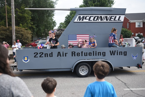 Members of Team McConnell ride McConnell's KC-135 Stratotanker-inspired float July 4, 2019, in Derby, Kan. Derby celebrated its 150th anniversary of being an established city during it's Fourth of July Parade. (U.S. Air Force photo by Airman 1st Class Alexi Myrick)