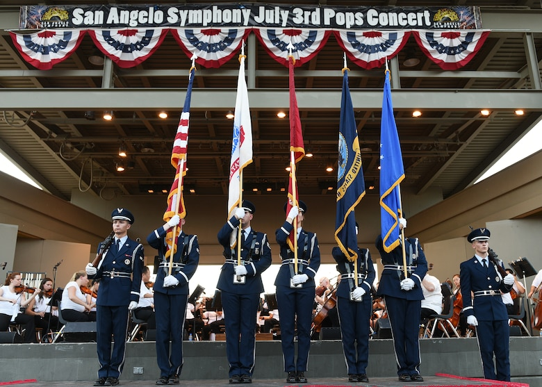 The Goodfellow Air Force Base Honor Guard presents the colors during the 32nd annual San Angelo Symphony Pops Concert at the Bill Aylor Sr. Memorial River Stage in San Angelo, Texas, July 3, 2019. Nearly 100 Goodfellow service members volunteered to support the free concert held as a celebration of Independence Day. (U.S. Air Force photo by Staff Sgt. Chad Warren/Released)