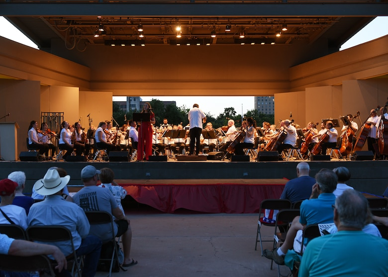 The San Angelo Symphony performs during the annual San Angelo Pops Concert at the Bill Aylor Sr. Memorial River Stage in San Angelo, Texas, July 3, 2019. The concert is an annual Independence Day celebration meant to honor the history of America and strengthen relations between San Angelo and the Goodfellow Air Force Base community. (U.S. Air Force photo by Staff Sgt. Chad Warren/Released)