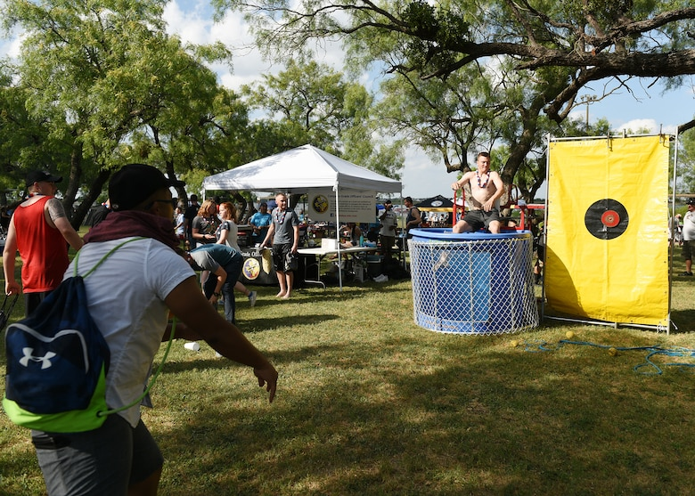 Attendees of the Goodfellow Air Force Base Independence Day celebration participate in the dunk tank at the Goodfellow Recreation Camp, Texas, July 4, 2019. The event provided food, music and family-friendly activities for base members and guests. (U.S. Air Force photo by Staff Sgt. Chad Warren/Released)